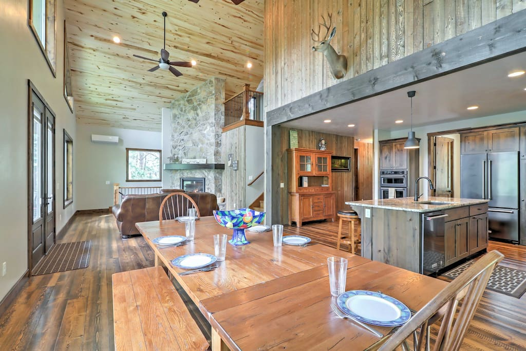 The newly constructed cabin features cathedral ceilings and rustic decor!