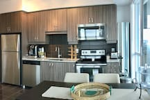 Kitchen with dinning table. Dishwasher, toaster oven, microwave and all kitchen stuff provided