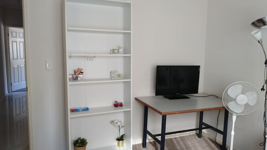 Plenty of shelfspace. TV, workdesk, additional fan and standing lights provided