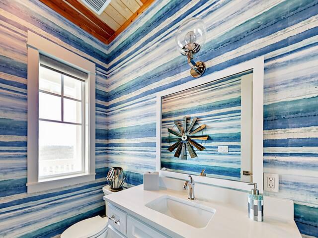 Cool ocean-inspired wallpaper in the second-floor half bath.