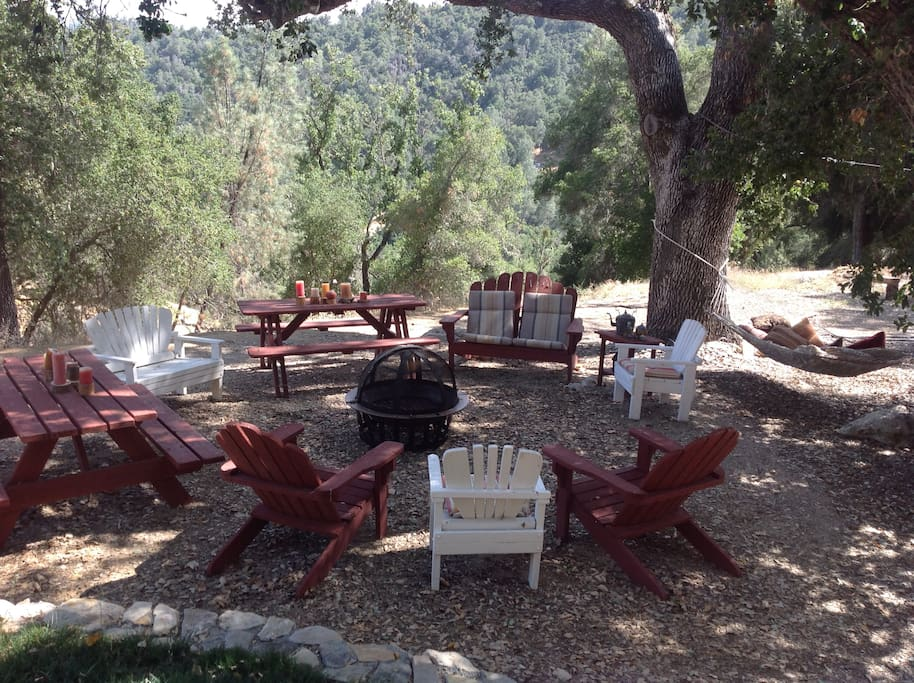 Outdoor picnic area with fantastic view, fire pit, bbq, hammock, swing set, game area, hot tub & more