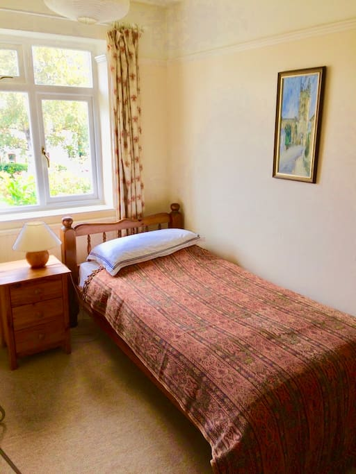 The single room has a bedside table, desk, chair and wardrobe. It is light and quiet.