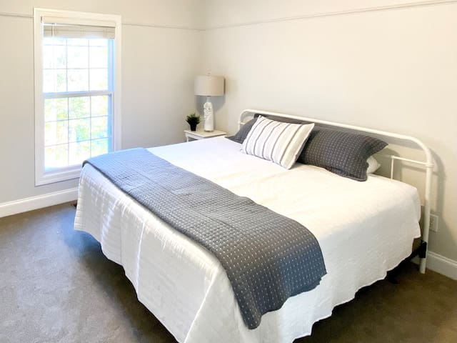 3rd bedroom with king bed, fresh paint, new carpet, and view of the lake.