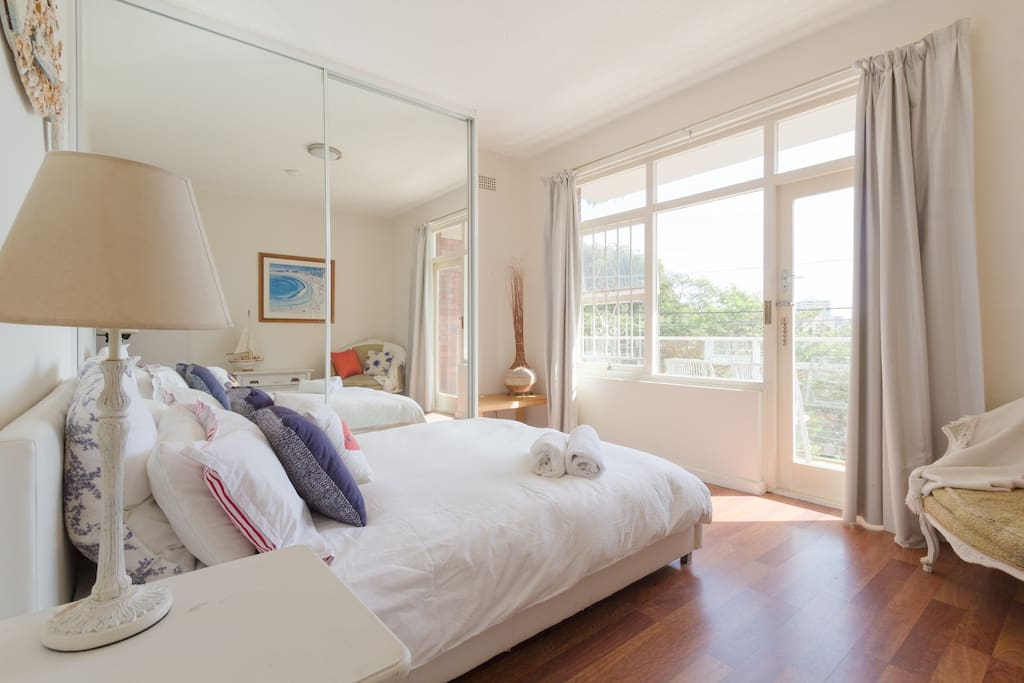 Sunny, bright bedroom with sunrise views!