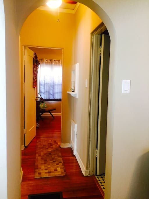 arched hallway leading to private bedroom