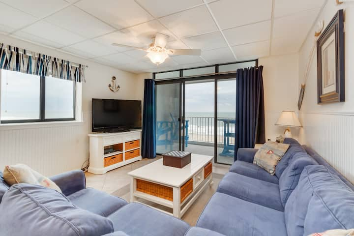 Waterfront condo w/ a furnished balcony, tranquil view, & full kitchen