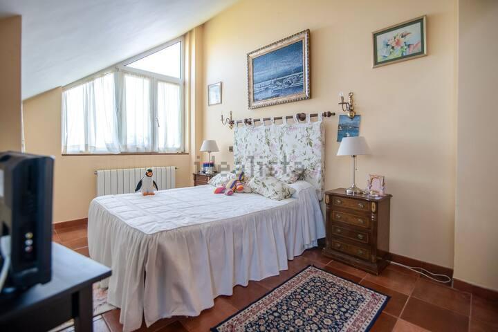 Habitaciones en casa familiar rodeada d naturaleza