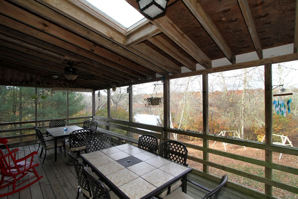 A spacious screened-in porch (off the dining area) offers a fantastic spot for group meals