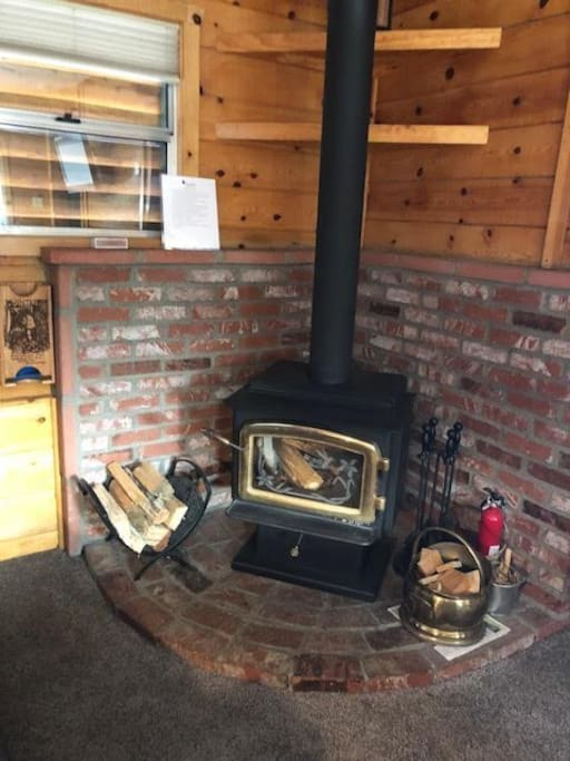 Cozy wood stove - all ready to go and plenty of wood to start again later.
