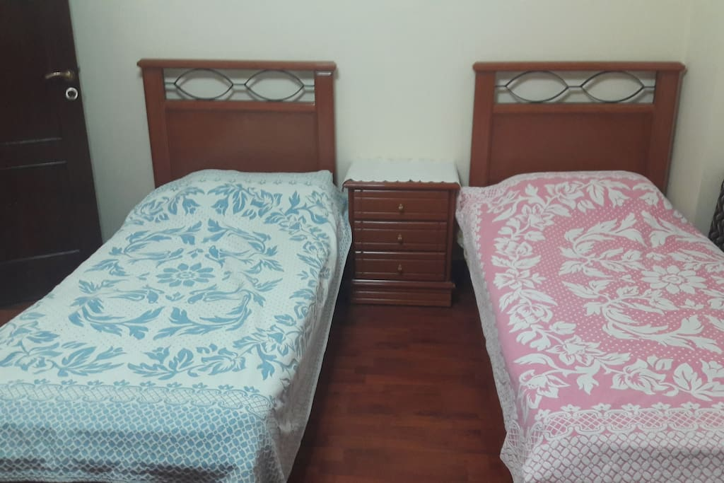 The two beds and the drawers