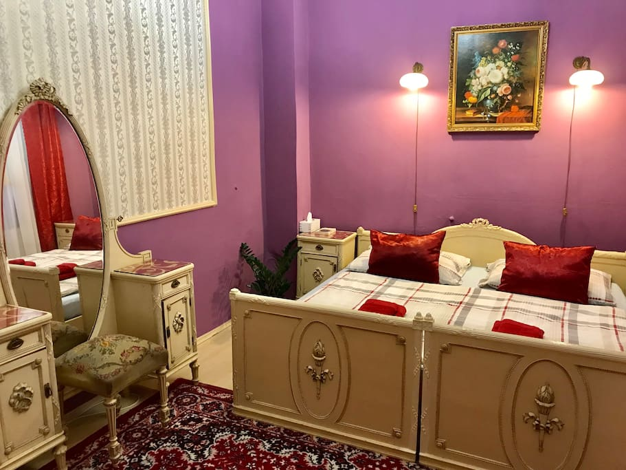 Purple bedroom with king size bed