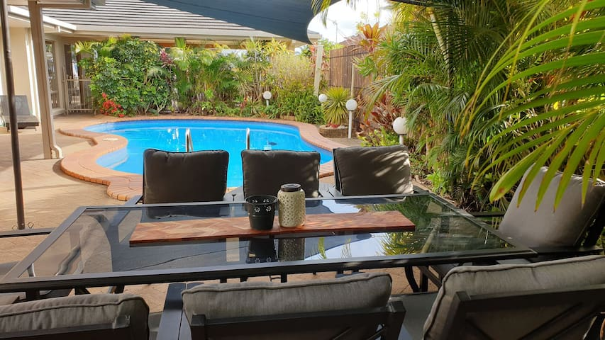 Shared outdoor area with barbeque, salt water pool.