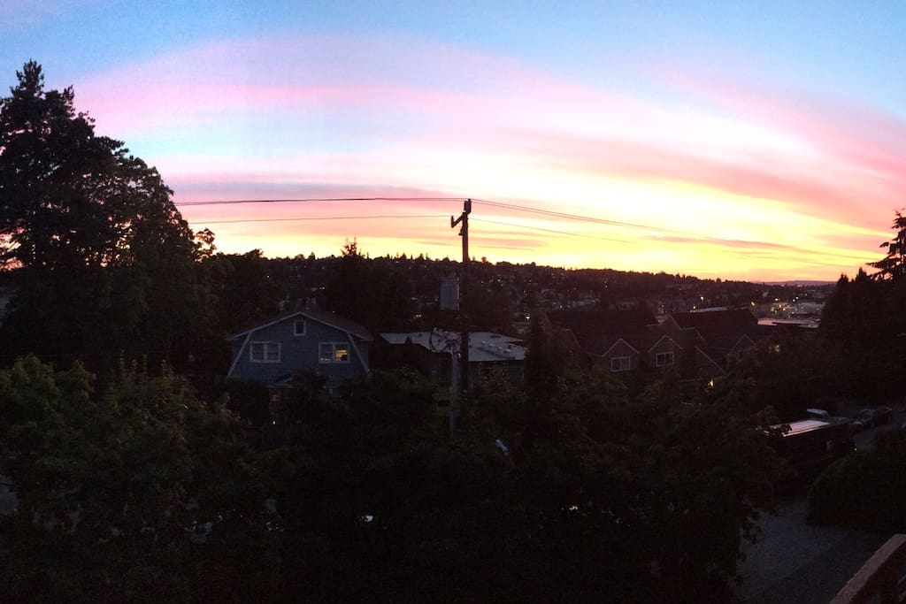 The view of Elliott Bay and the Sound from the balcony (comes with killer sunsets).