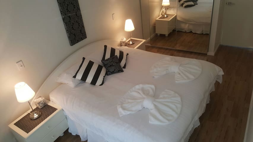 Bedroom 1 with large mirrored built-in robes