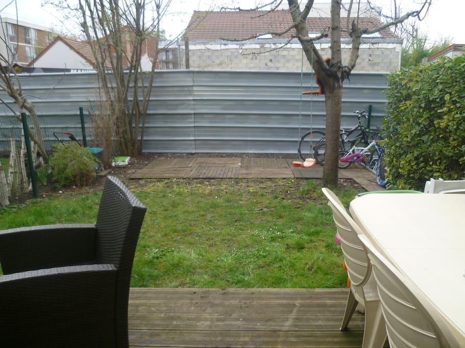 Jardin avec terrasse bois