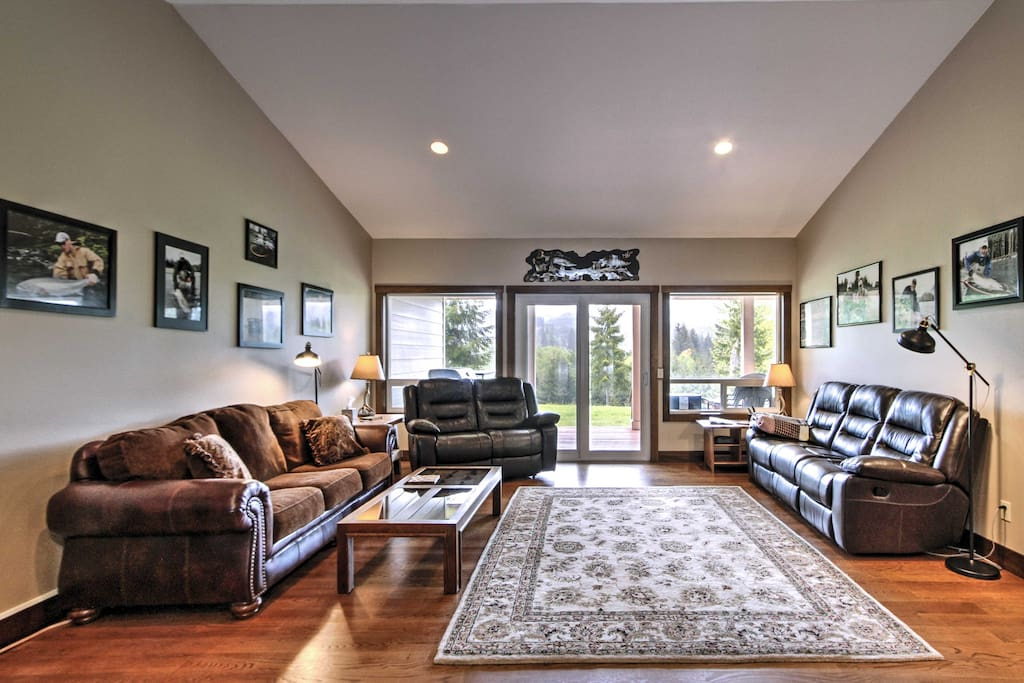 The living space features pristine hardwoods floors, an electric fireplace and natural light flooding from sliding patio doors.