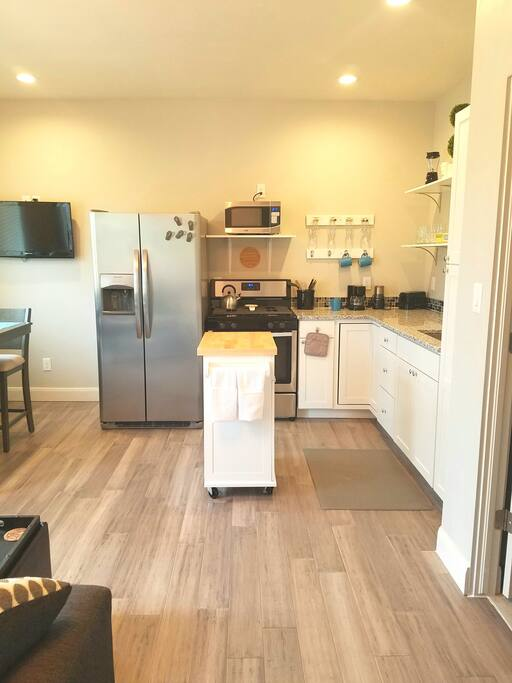 Full-size gas range and stove, refrigerator and microwave. Dishes and pantry staples available