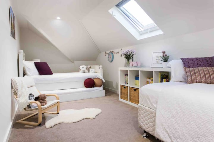 Second story bedroom.  Sleeps three on two single beds and single trundle.  Air- conditioning