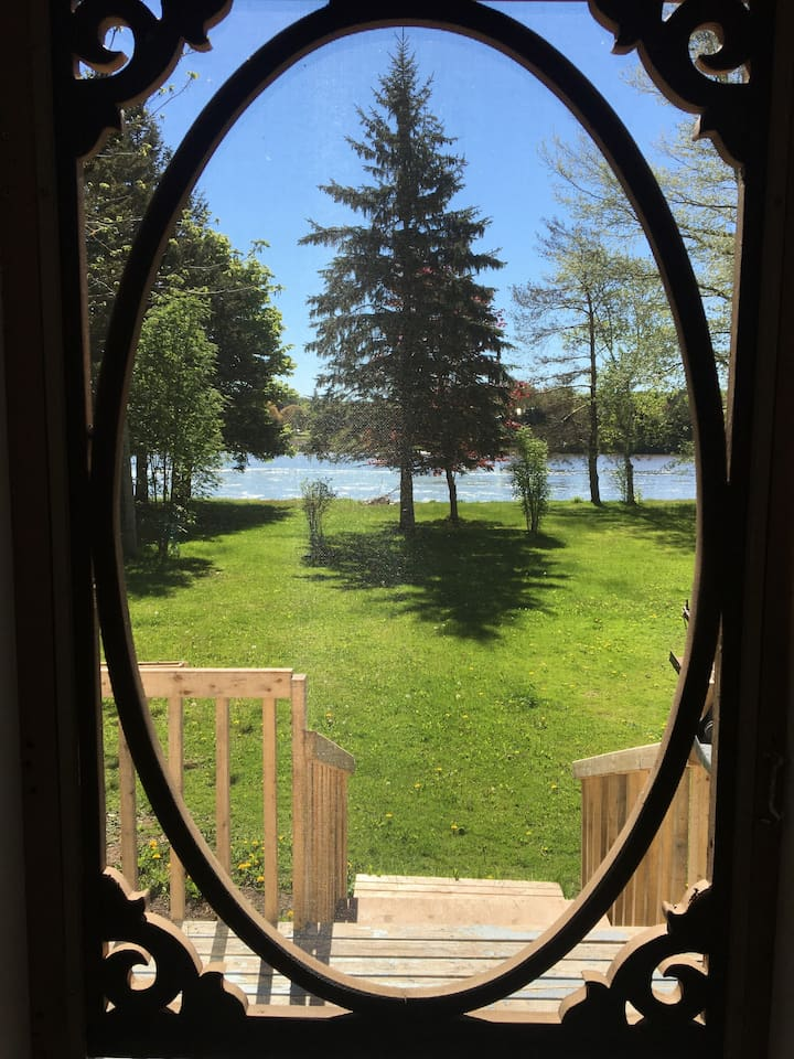 Sunroom screen door leading out to beautiful river view.