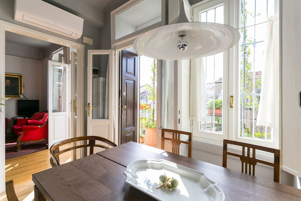 kitchen and sitting room entrance doors, both opening onto the balcony