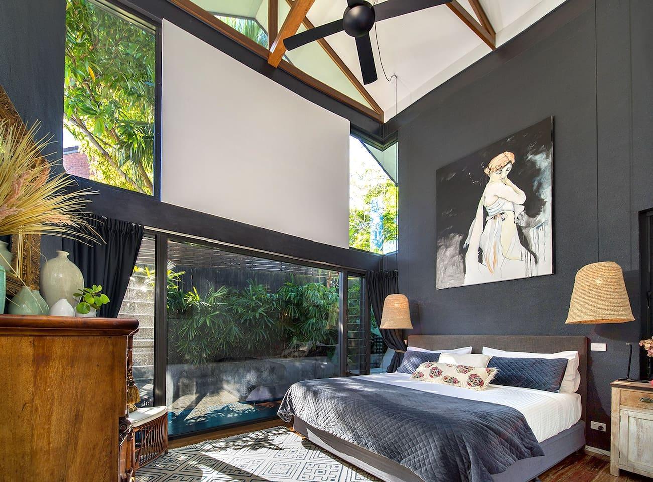 Main bedroom with very high rake ceilings