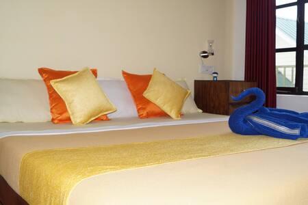 Grace Inn Munnar, Yellow Room - Idukki - Huis