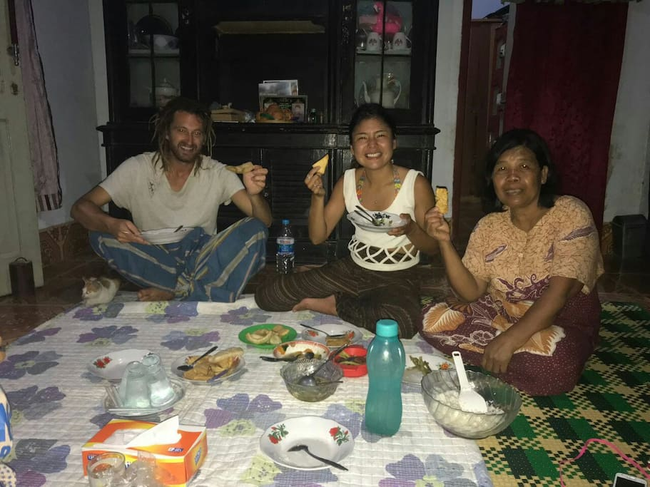 """happy guests from Japan enjoying """"makan""""(eating)-time with Ibu Budi traditionally on the floor"""