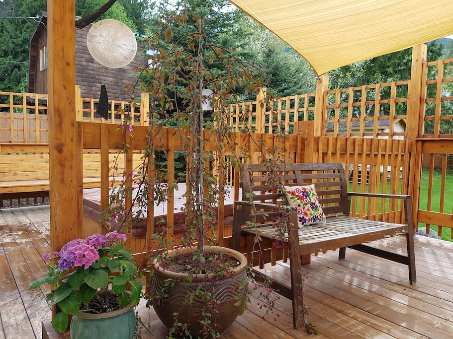 Sun Shades adorn the deck for outdoor dining comfort