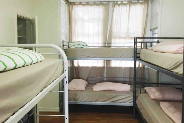 Bunk bed in shared room by USC/Metro ExpoLine