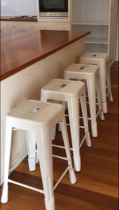 New bar stool seating at the large kitchen island bench.