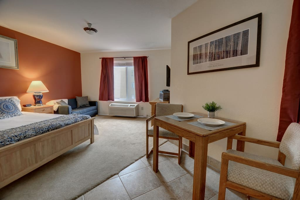 Spacious Studio with Queen Bed, TV, Kitchen & Dining