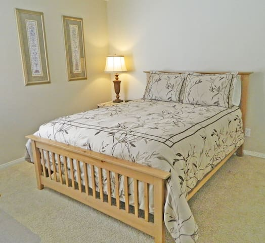 Welcome to your room! Private large bedroom with a queen size bed (Mountainside Bedroom)