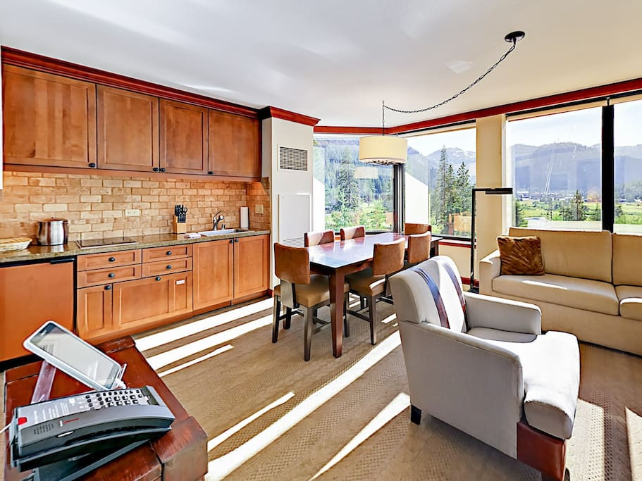 In between the kitchenette and living room is a heavy, alpine-themed dining area that seats 6.