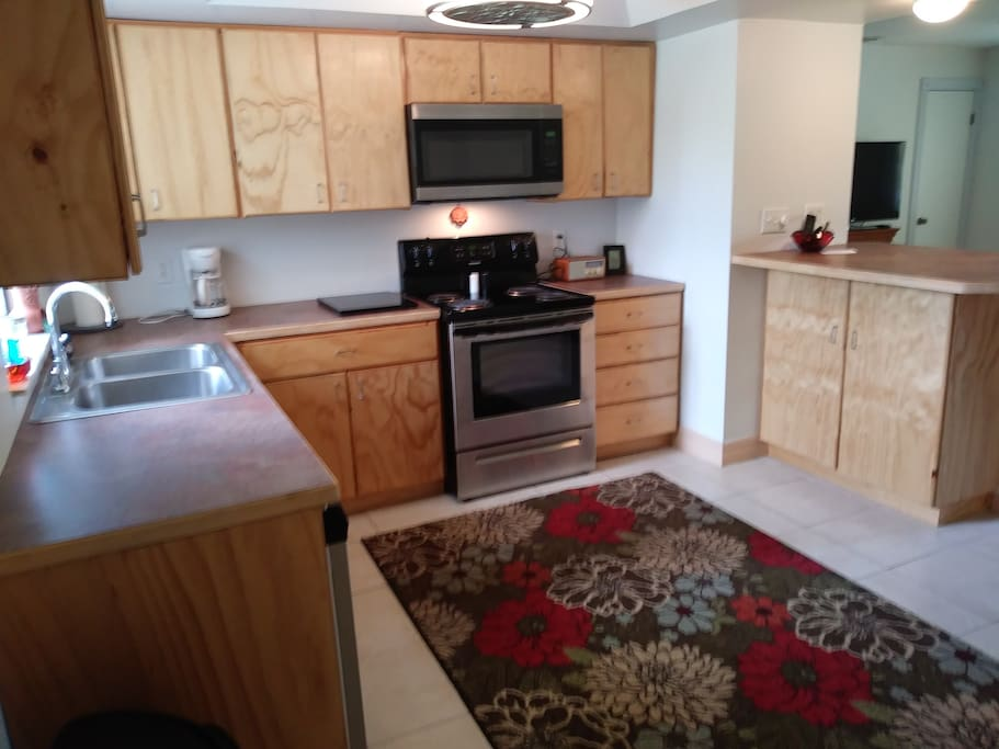 open kitchen with new cabinets and appliances