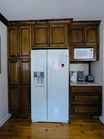 Kitchen w/ large fridge, Keurig (& coffee!), dishwasher, gas stove/oven, toaster, and microwave.
