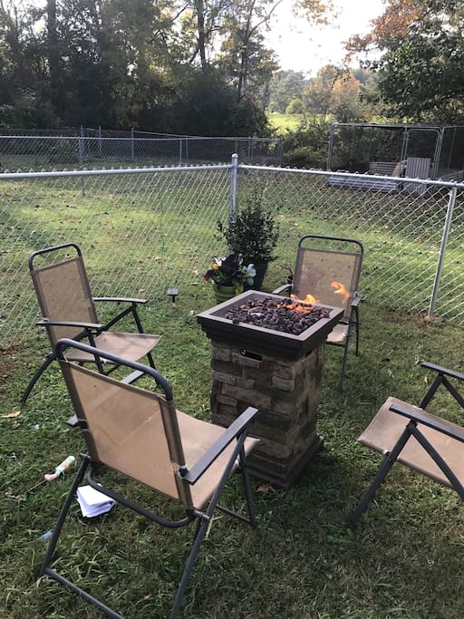This is the backyard with a fire pit.