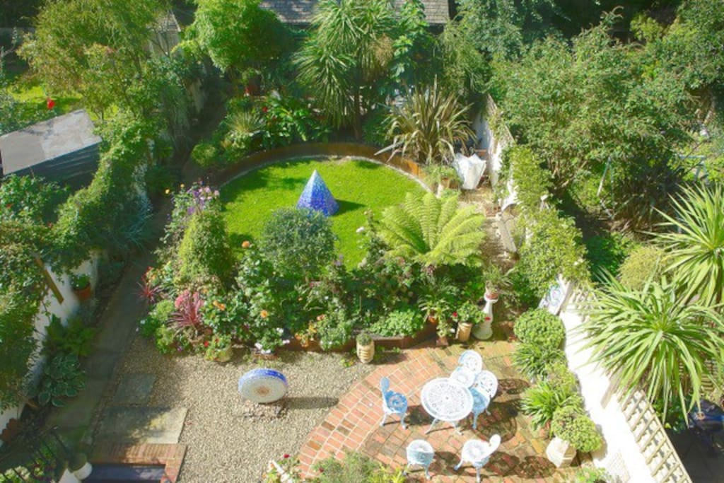 Stunning private garden with space to eat, socialise, soak up the sun and admire the beautiful sculptures