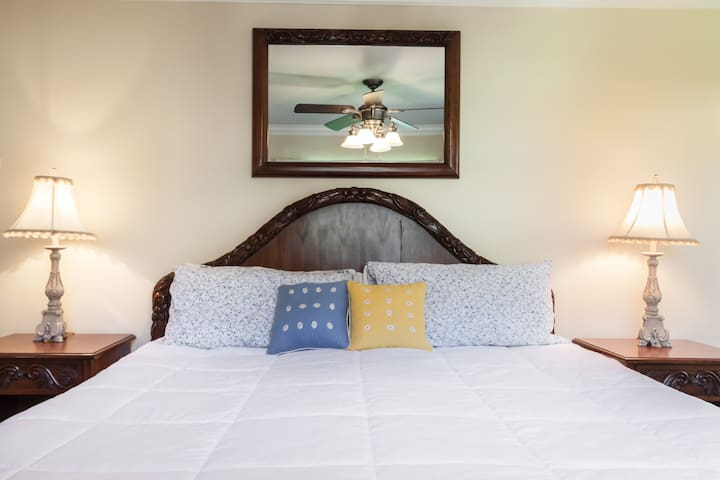 Master bedroom with king size bed and 2 night stands
