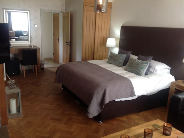 Private suite, sofa, log burner, luxury en-suite