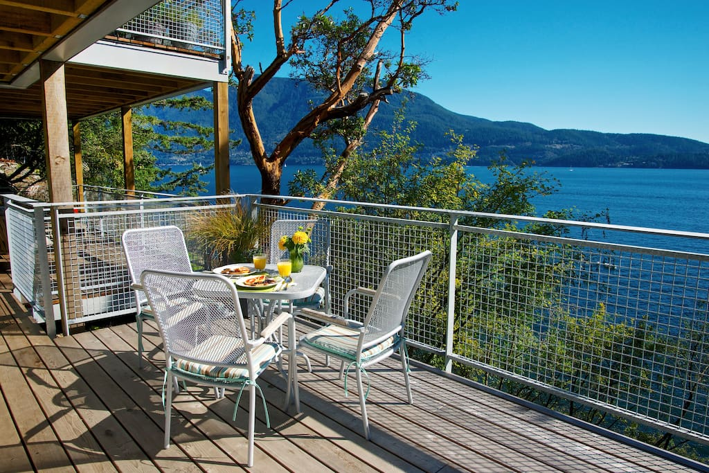 The Lazy B Waterfront Suite has expansive sun drenched seaside decks with patio dining for 4 and a briquette BBQ. 1 minute to beach