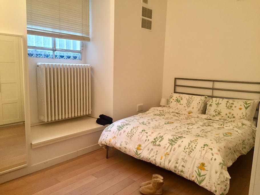 Queen bed with fitted wardrobes