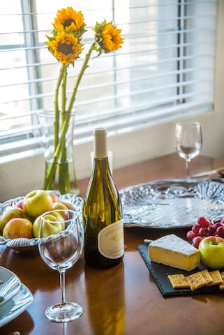 Enjoy your meals on the dining table with a picturesque view of the Huntington Harbor canal outside the window.