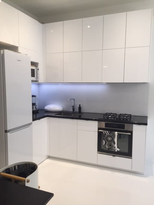 The apartment has a brand new and spacious joint kitchen & living room with all the necessary appliances (coffee maker, microwave, toaster, oven etc).