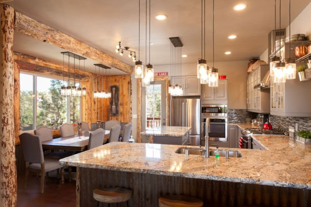 Granite and glass tile kitchen with all cookware and flatware needed for that perfect meal in the mountains.