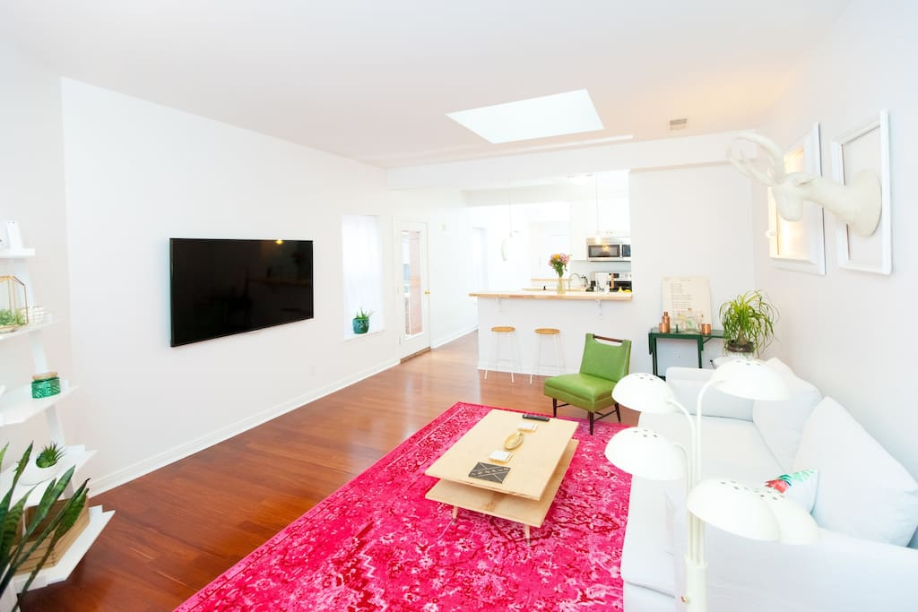 """The living room has a a 65"""" smart TV, great for lounging after a long day of exploring the city."""