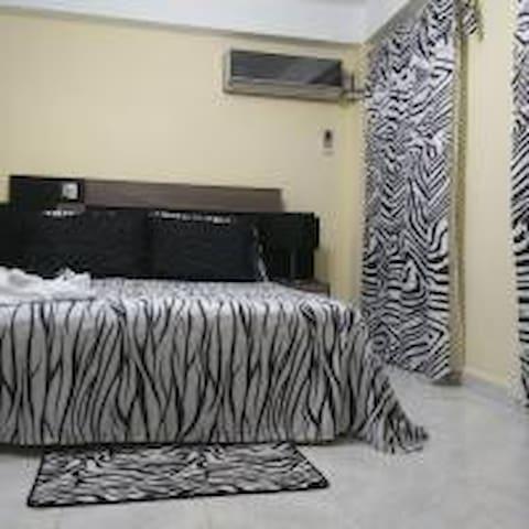 """Nancy's rent  room """"La casa de Las Frutas"""""""
