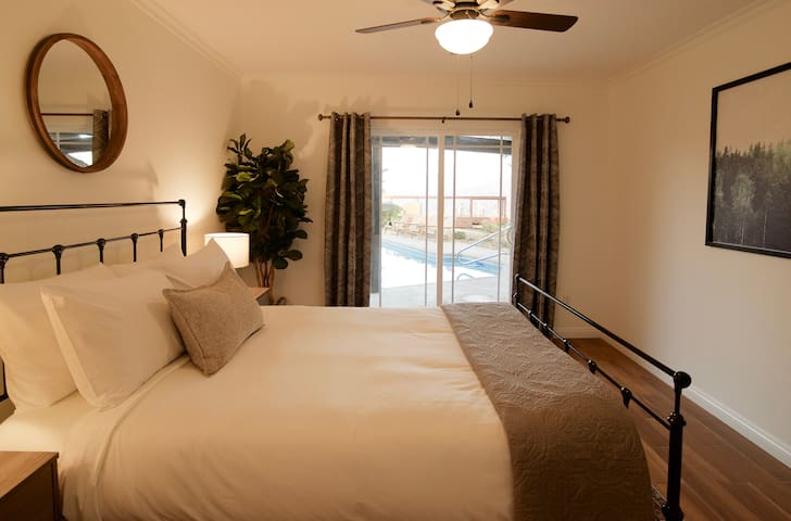Walk out to the pool and hot tub from this queen bedroom  or simply enjoy the views without even leaving your room.