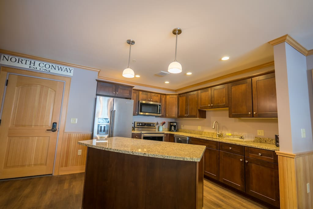 Fully outfitted kitchen has everything you need to dine in, including cutlery, dishes, pots and pans and coffee maker.