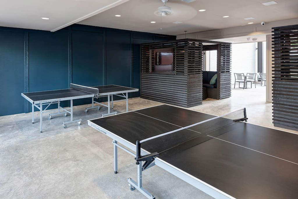 Ping Pong tables are near the apartment to play a nice game.