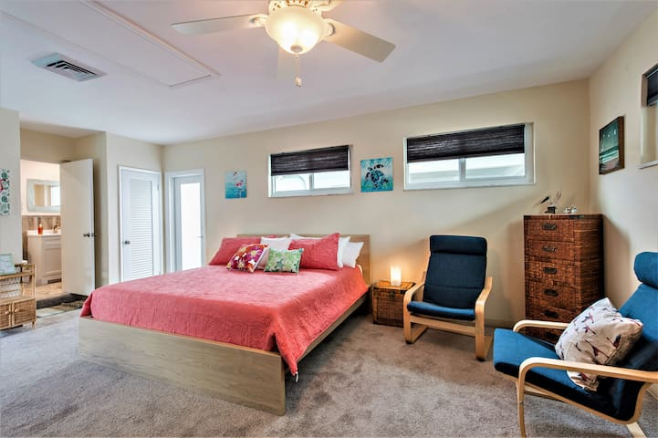 Spacious third bedroom has large sitting area and HDTV.